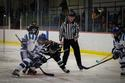 Katie Parkman '17 fights for the puck against a Bowdoin defender. (PHOTO: Jade Thomas '20)