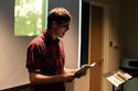 Cain '13 reads from his recently published work, Kids of the Black Hole; Photo by Dan Tu '20